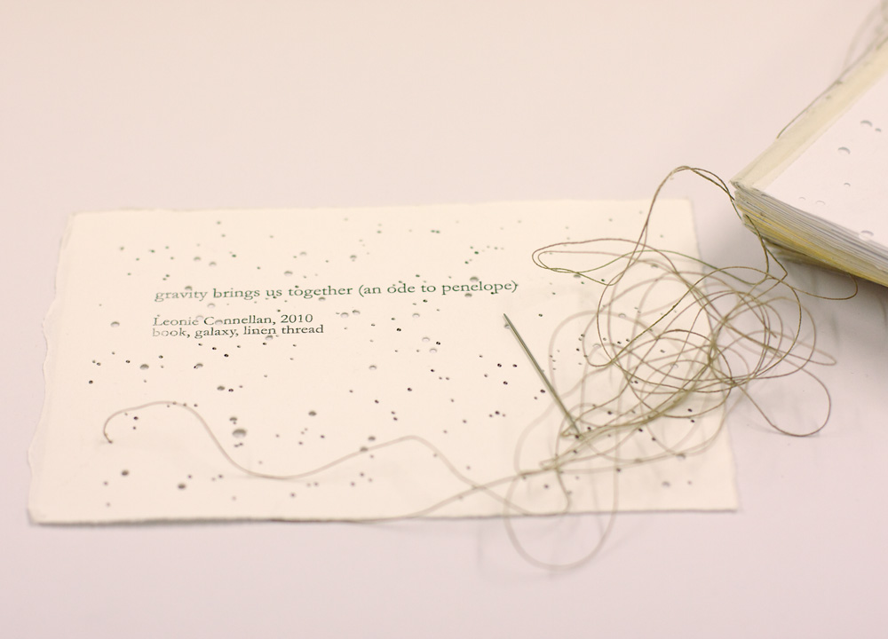 Gravity Brings Us Together (an ode to Penelope) Detail. Artist's Book: The Odyssey, linen thread, needle, galaxy. 2010.
