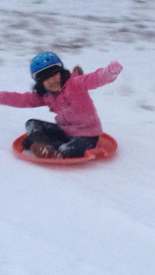 Girl 2 loves sledding!