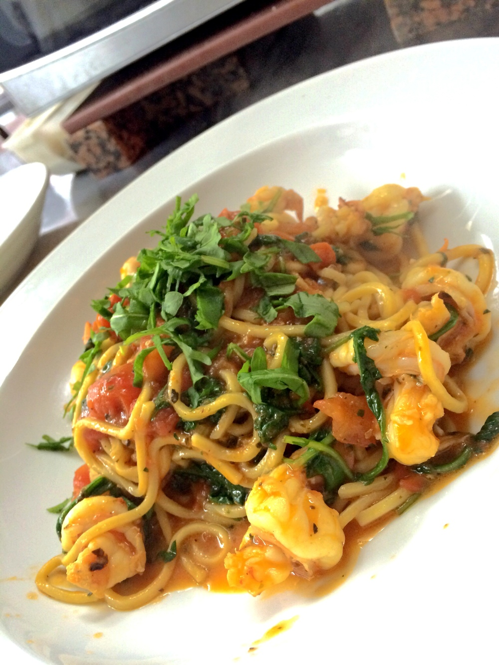 spaghetti with shrimp, arugula, in a cherry tomato sauce
