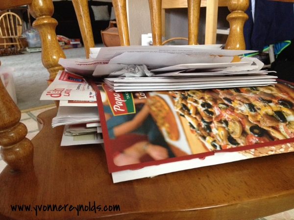 Junk mail and paid bills that need to be organized