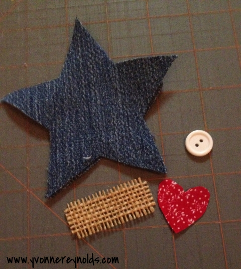 denim, burlap, fabric heart, and a button