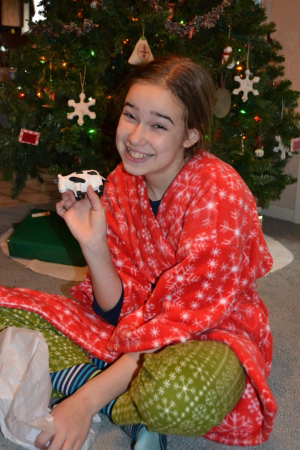 Kelsey with our Cow ornament, December 2011