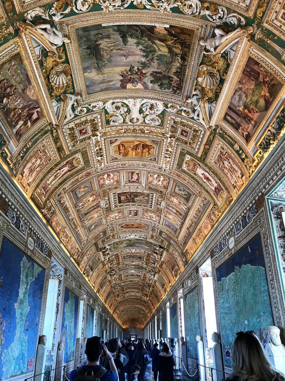 Hall in the Vatican Museum with maps of regions of Italy
