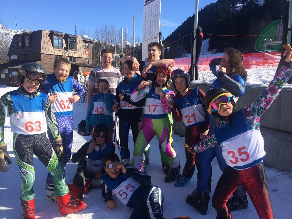 "The Juneau Ski Team at the U12/U14 state champs at Alyeska.Resort ""'cause we never leave home without our Chef Stef's granola bars!""."
