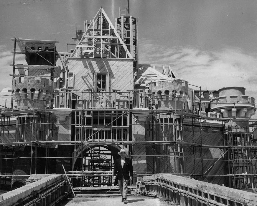 thruwaltseyes: Walt Disney proudly stands on the construction site of the Sleeping Beauty Castle.