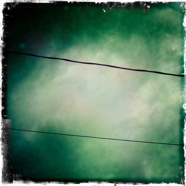 Sky with power lines John S Lens, Kodot XGrizzled Film, Dreampop Flash, Taken with Hipstamatic