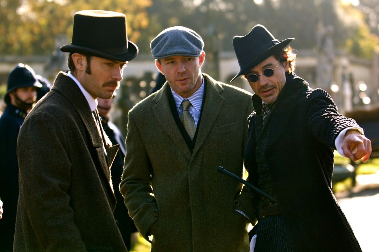 fuckyeahdirectors: Jude Law, Guy Ritchie and Robert Downey Jr on-set of Sherlock Holmes 2009