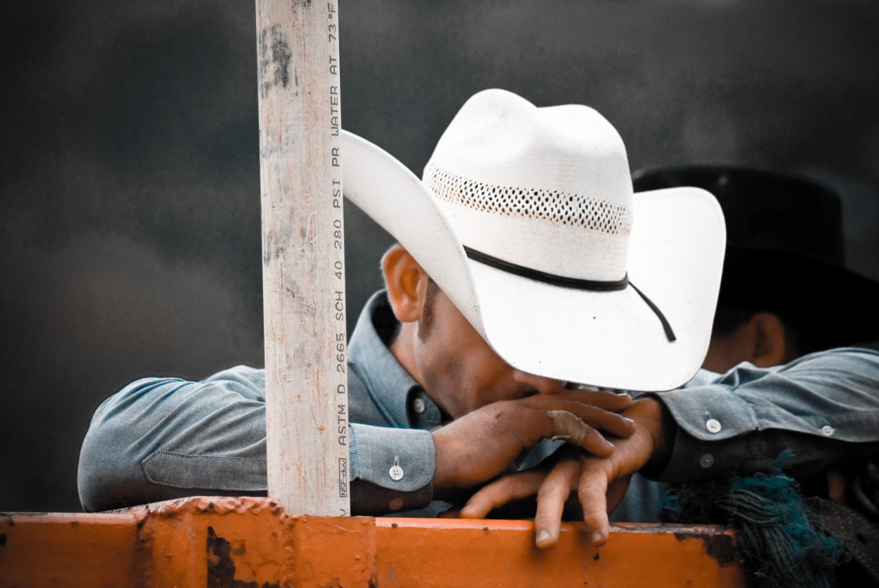 """pictoryblog: Minutes before this cowboy's turn in the ring versus a 1,700 pound bull, he takes a minute to say a prayer and collect himself. The only thing that stands between him and making it out of the ring unscathed are a few rodeo clowns and courage. — By Kevin Furst (from """"Open Theme"""") Submit now to Pictory's Open Themes"""