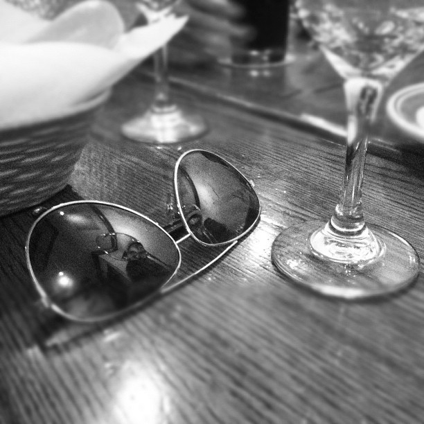 Sunglasses on wood with wine glass (Taken with instagram)
