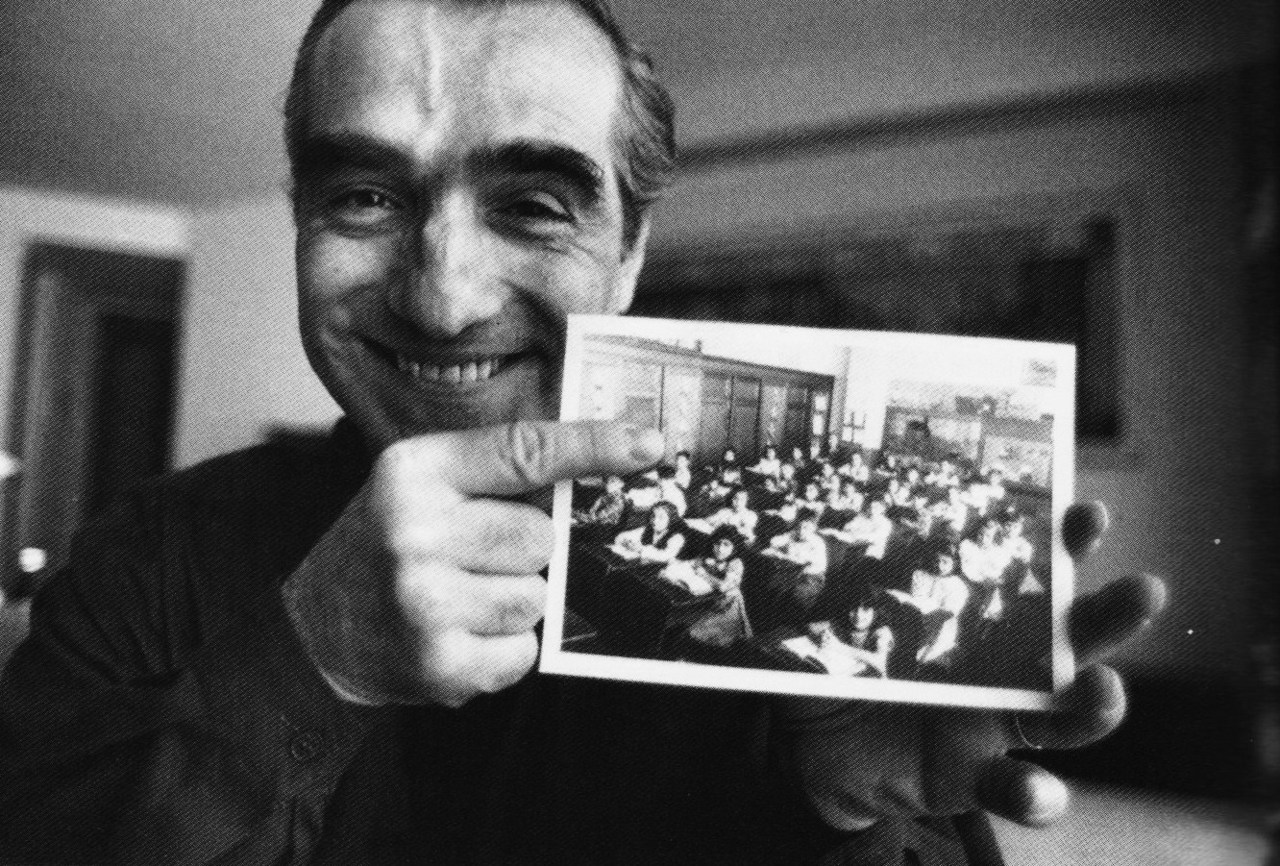 Martin Scorsese showing photographer Ferdinando Scianna his class photograph in a Manhattan school, 1990.