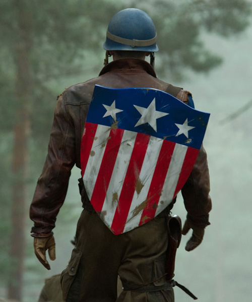 """totalfilm: Captain America review If the biggest obstacle with Captain America is not turning a flag-wearer into a flag-waver, job done. Following the Marvel template, it's more about individual pluck than national pride; less a salute to Uncle Sam than a fanfare for the little man – as embodied by Steve Rogers (a digitally emaciated Chris Evans), a """"90-pound asthmatic"""" unfit for military service, circa 1942. But the kid's got guts and he hates bullies, pegging him as the ideal subject for an experimental super-soldier serum that makes him look, as Clive James once said of Arnie, """"like a condom stuffed with walnuts"""". Thus, Captain America is born – first as a baby-holding propaganda patsy, then as a two-fisted, shield-spinning Nazi-fighter. Yes sir"""