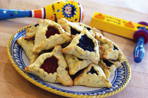 "Hamantaschen (""Haman's Ludicrously Giant Ears"") are Purim's traditional treat...."