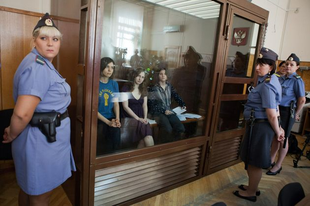 "Members of Pussy Riot in a Moscow courtroom, on trial for their ""punk prayer"" in a local cathedral; from left, Nadya Tolokonnikova, Maria Alyokhina, Yekaterina Samutsevich"