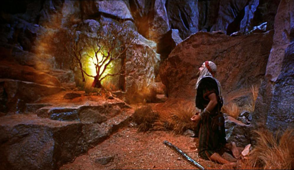 Charlton Heston's Moses pays solemn deference to God in the Burning Bush in DeMille's The Ten Commandments.  Even though the Bush is comparatively wimpy (compared to other Bible movies), Chuck's hair as a result of this interaction becomes become enormous!