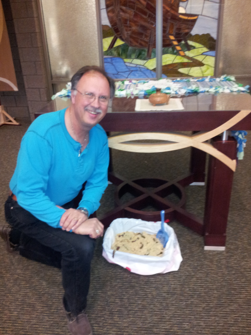 Pastor Dennis, Bremwood's chaplain, posing with my April Fools offering, in the Bremwood Chapel.