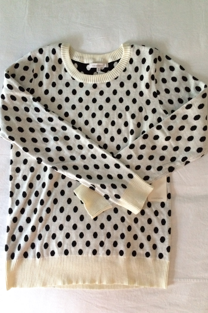 One polka dotted sweater.