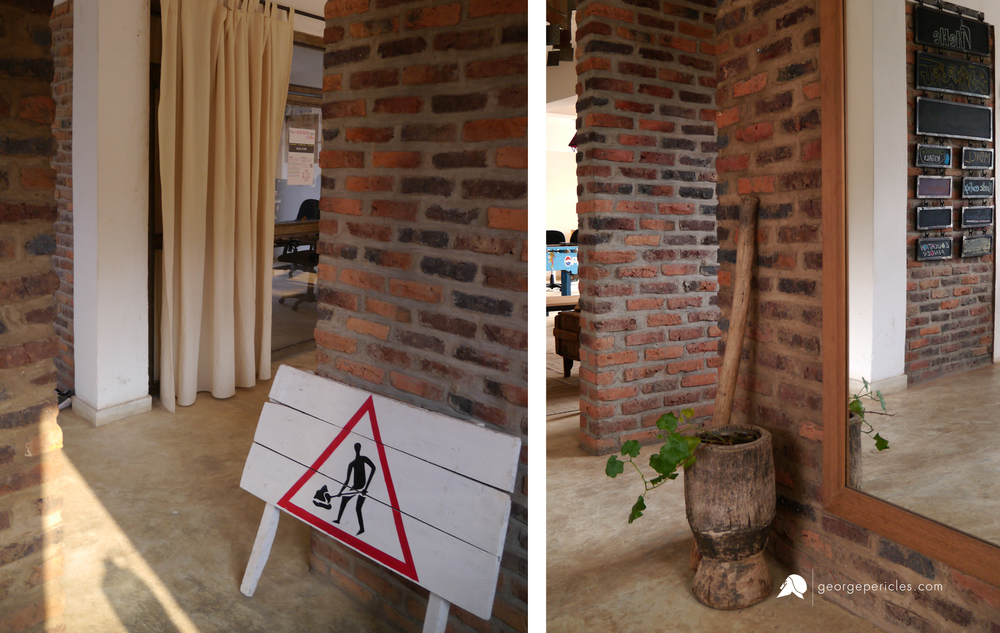 The Office Lobby, with a Rwandan antique mortar