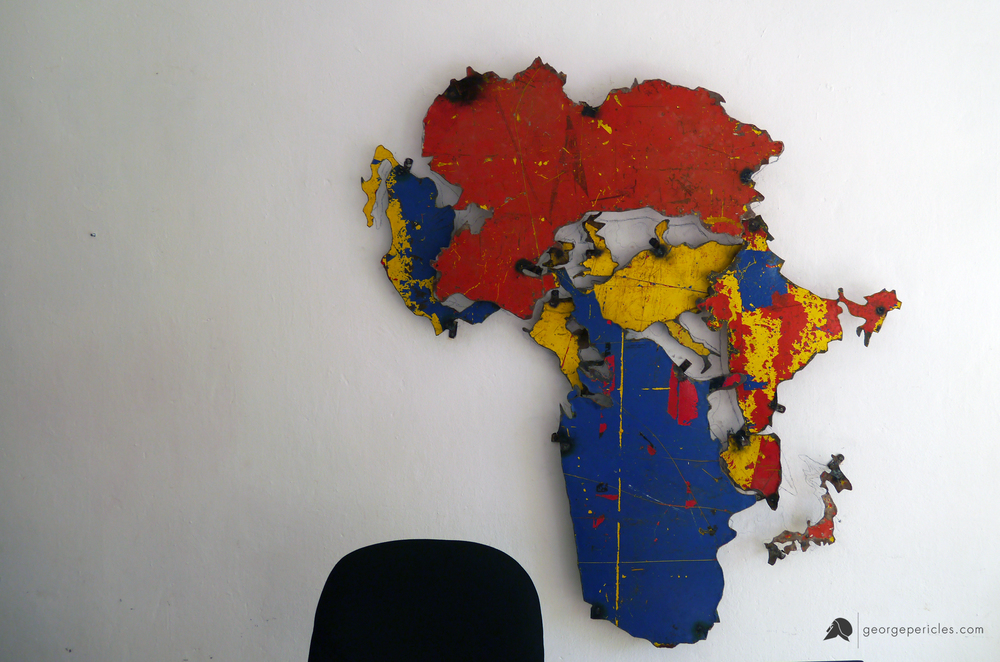 "Wall-art in the working area. ""The True Size of Africa"" , made of reclaimed metal sheet"