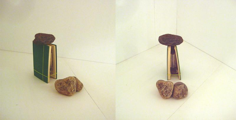 The book installation was accompanied by three rocks.