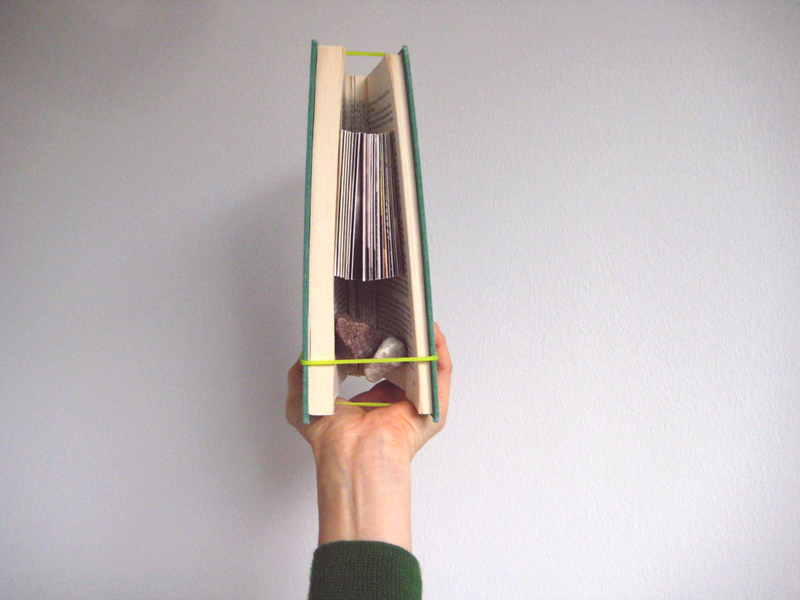 An accordion book created for Shikukaru, an art exhibition held in Tokyo, 2012.   It was renewed from an used Finnish book, book installation accompanied by two rocks.