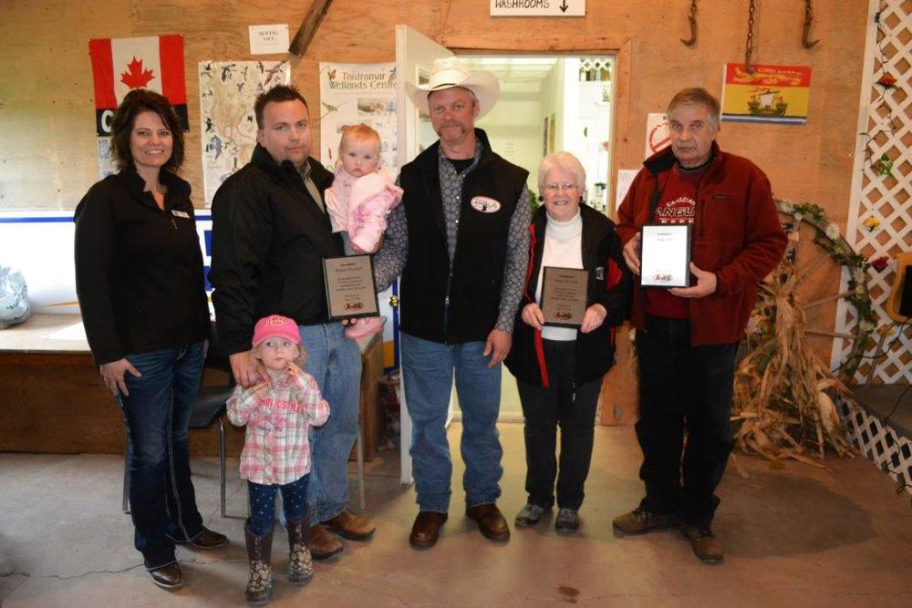 Left to right: Corinne Gibson, Canadian Angus Association president (Six Mile Red Angus, Fir Mountain, Sask.); Kurt, Kinley, and Karly Duncan, 25-year member (Duncan Livestock, Cornwall, P.E.I.); Trevor Welch, Maritime Angus Association director to the CAA Board and Past President of the Maritime Angus Association (Garvie Farms, Glassville, N.B.); Betty Lou Scott, 25-year member and 25-year Secretary-Treasurer Maritime Angus Association (WindCrest Farm, Mt Thom, N.S.); and Bill Scott accepting on behalf of Sandy Scott, 25-year member, also of WindCrest Farm. Dr. Bill Best of P.E.I. also qualified for a 25-year award but was unable to attend the Field Day in Port Elgin on June 13-14, 2014. (Photos by Emily Pipes)