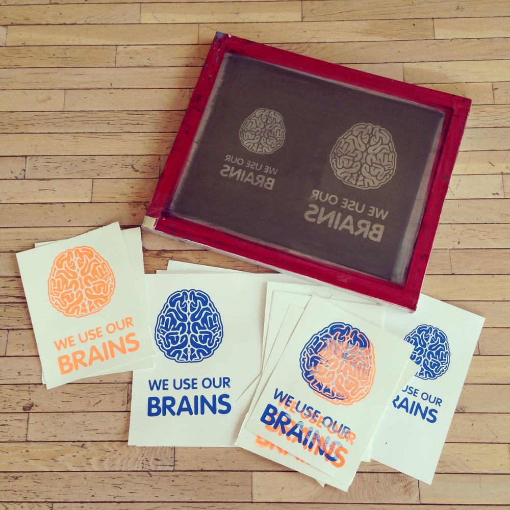 Experimenting with our WE USE OUR BRAINS screen prints.