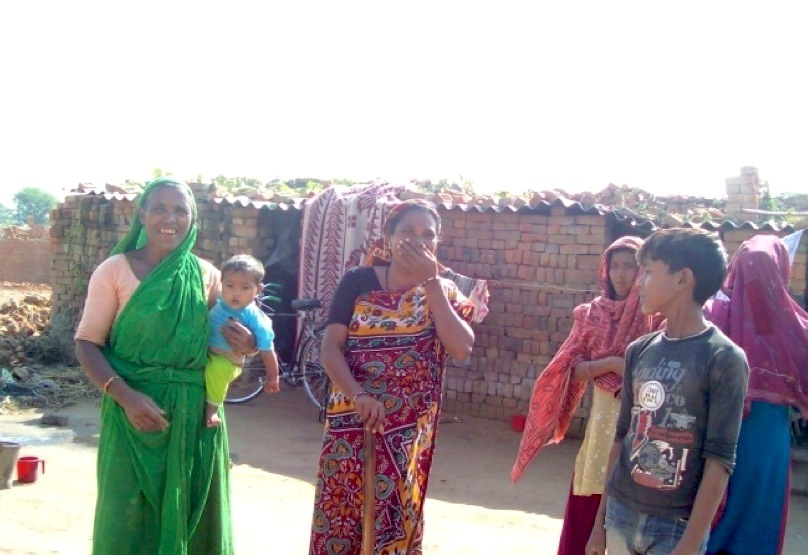 Camera-shy Khatuni (in red) and her mother-in-law (in green)