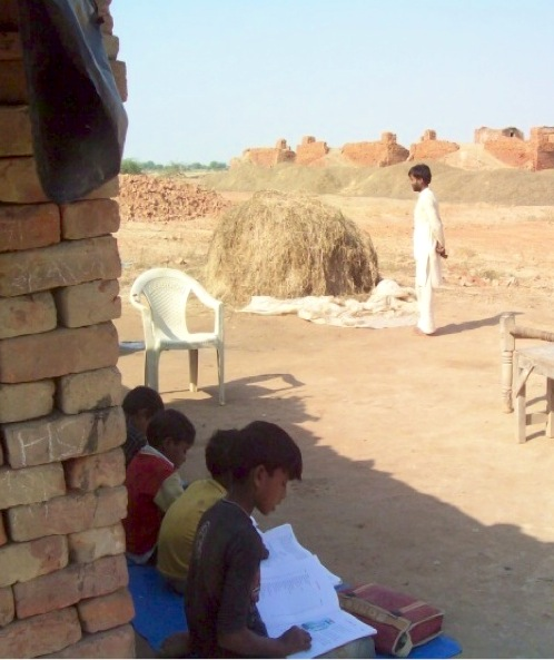 Khatuni's children study in the shade