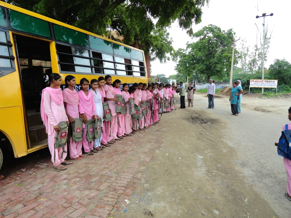 Girls line up for their Blossum Bus ride!