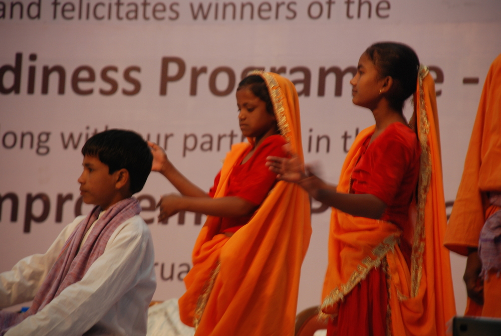Children performing in praise of education