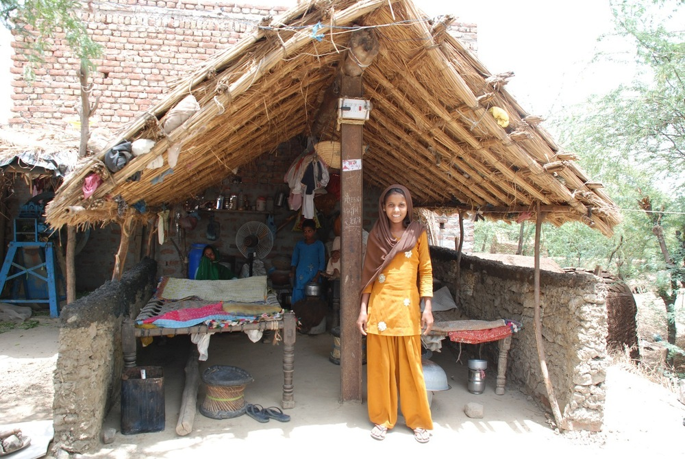 21_Afsana in front of her current dwelling.jpg