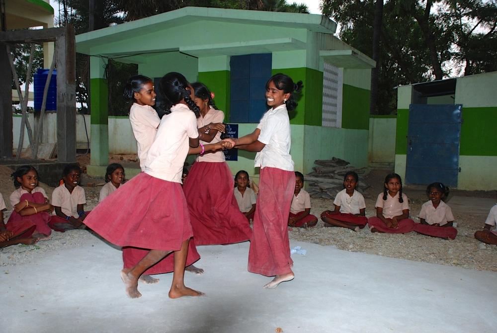 Pattankullam Village School girls perform a dance at their Lotus Tutors class