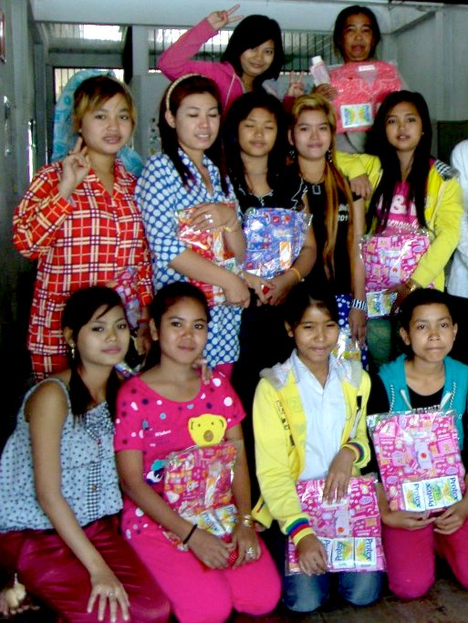 Srey-Pov (bottom row 2nd from left, in pink) with her 2010 NFE graduating class