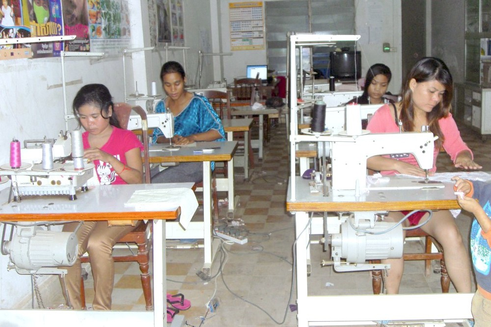 Srey-Pov (front row, left) in sewing class
