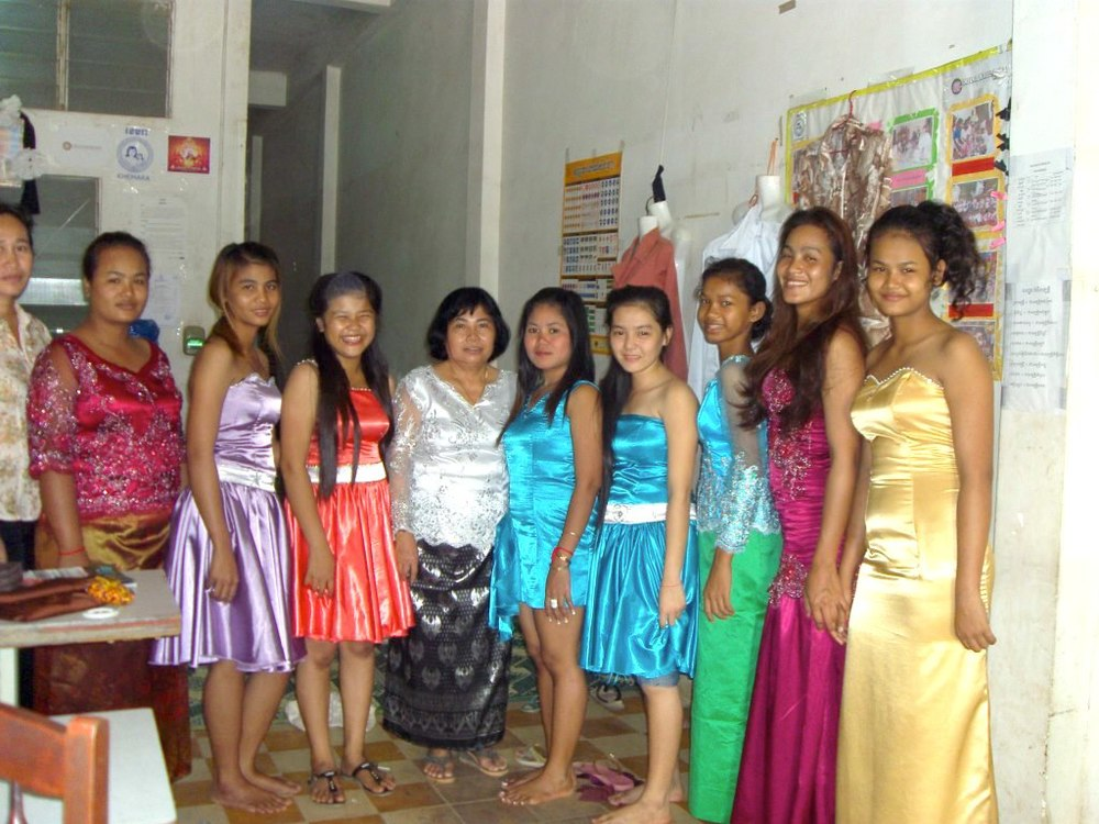 Srey-Pov (center in blue) wearing a dress she created and sewed