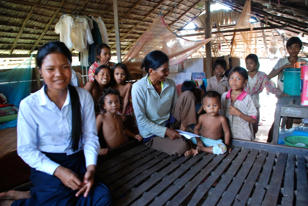 Sokpoan with her mother, her siblings and several extended family.