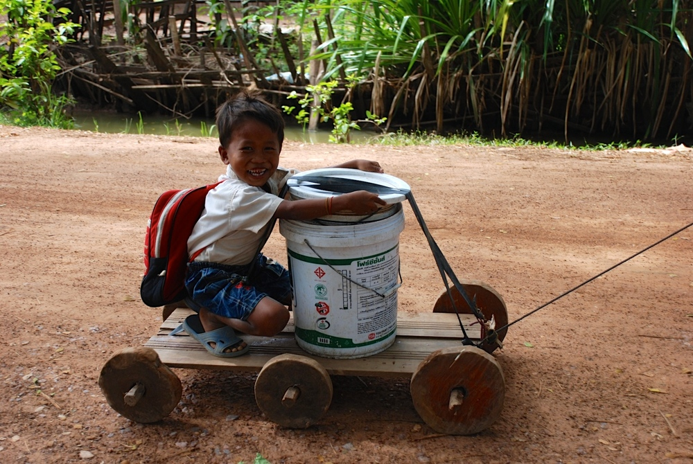 Sokpoan's younger bother having fun on the farm cart