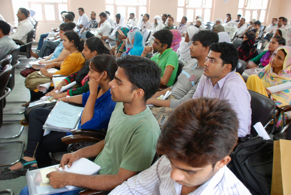The Delhi University students listen to District Officers of Harayana address 120 School Management Committee members on the latest Right to Education developments in the state