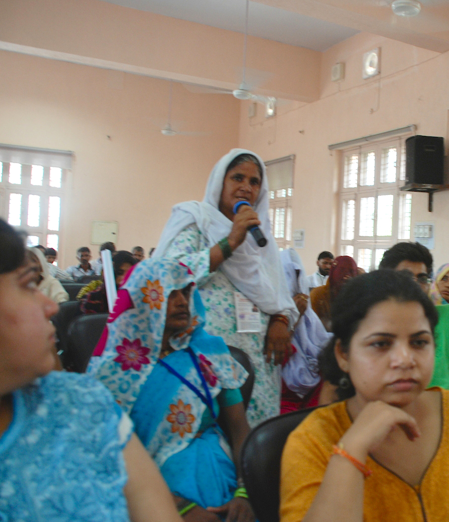 A female SMC member speaks to the gathering