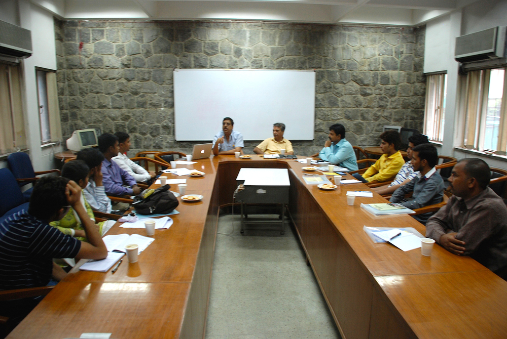 Ambarish Rai (head of table, at left) addresses university students at Centre for Social Development
