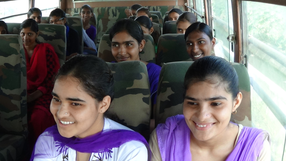 Blossom Bus girls on the way to college!