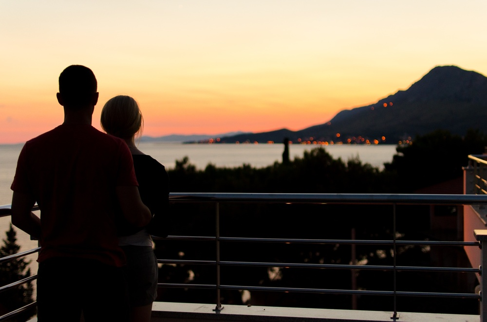 COUPLE STANDING PEACEFULLY SUNSET.jpg