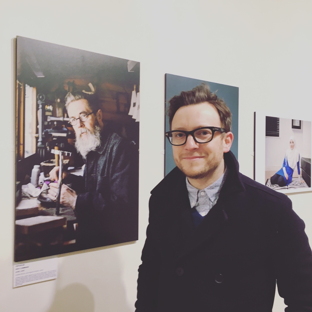 Standing proudly by the portrait at Mall Galleries