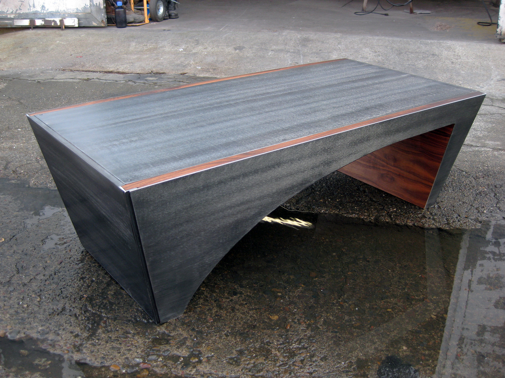 Custom Steel Slope Coffee Table  Shown with walnut inlays.