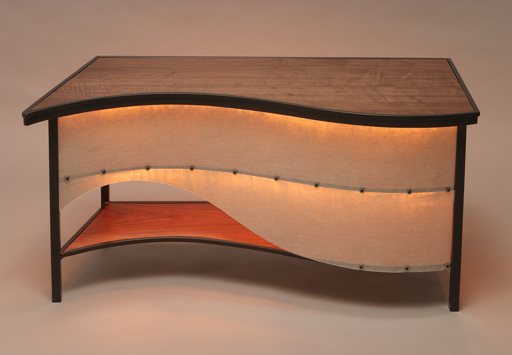 Custom Curved Lit Side Table  Walnut, rice paper Lumicor inlay, steel.