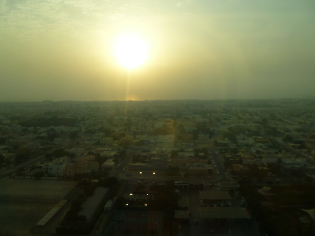 Watching the sun set into the hazy horizon of the Arabian Gulf, from the club lounge room at the Towers Rotana.