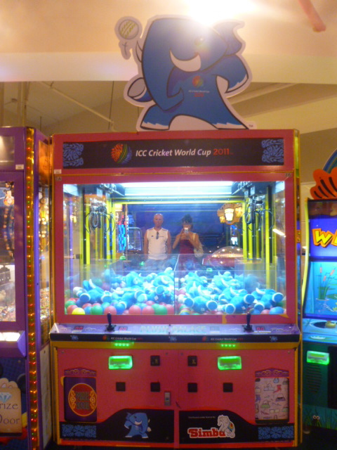 A Cricket World Cup themed toy machine in an arcade.