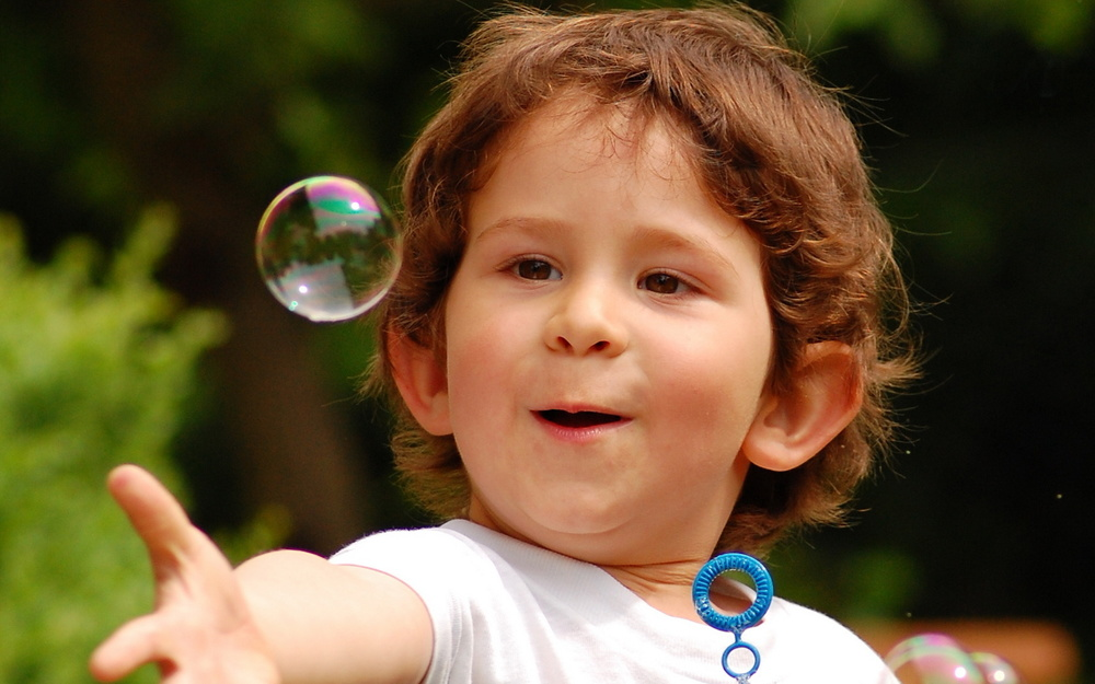 happy_child_touching_bubble-wide.jpg