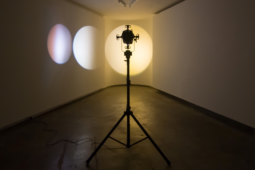 Michaela Gleave  2015   Eclipse Machine (Magenta, Orange)   Theatre lamp, dichroic filters, motors, powder coated aluminium, stand  Installation view: Firstdraft Gallery,as part of the exhibition  As if light could be translated , curated by Art Proper (Annika Kristensen and Samantha Willams)