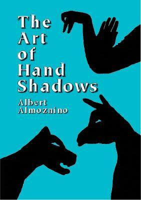 THE ART OF HAND SHADOWS by Albert Almoznino (There are lots of hand shadow books around but we have this one and it's pretty easy to replicate the hand shadows successfully.)